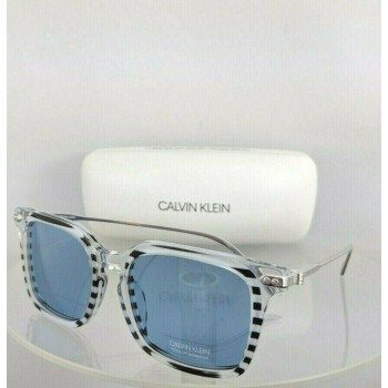 Calvin Klein CK 18702S 972 Black & Clear Sunglasses